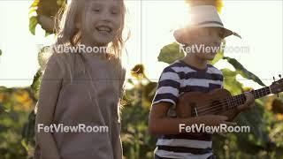 Happy childhood. Children in yellow sunflowers.