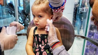 TWO YEAR OLDS GET THEIR EARS PIERCED