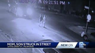 Truck slams into mother, son crossing street