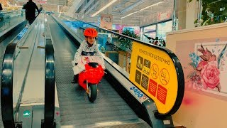 Funny Den ride on red sportbike to the kids store buy new toy