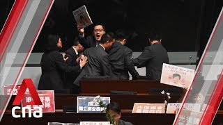 Hong Kong lawmakers dragged out of LegCo chamber for heckling Carrie Lam