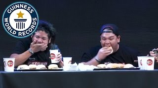 Most burgers eaten in one minute - Guinness World Records