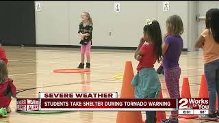 Students take shelter during tornado warning