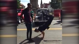 Police Officer Challenges Street Performer to Epic Dance Battle