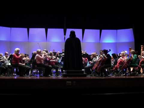 Darth Vader conducts the Imperial March when the Central Garrison invades the Rochester Symphony.