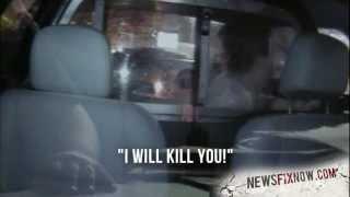 Woman kicks out police cruiser window