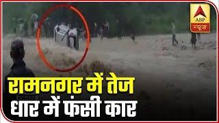 Woman dies as car sweeps away in overflowing floodwater..