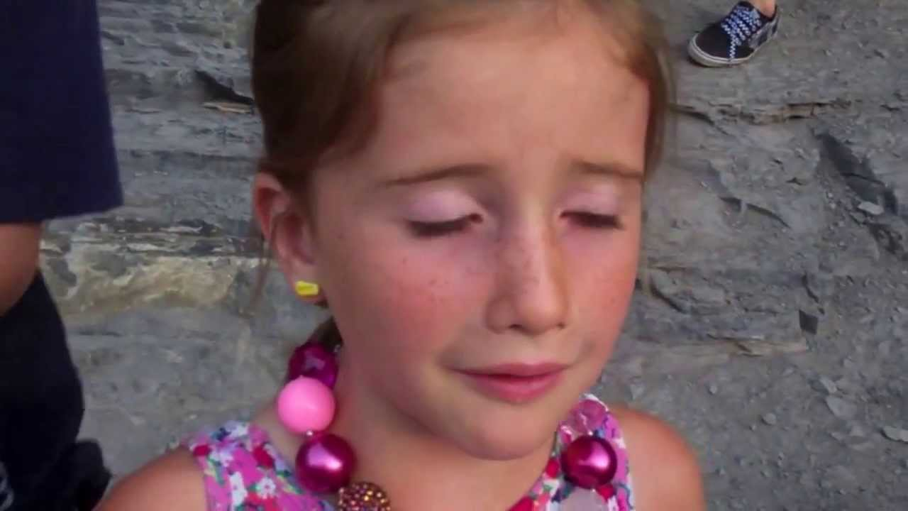 Little girl almost falls off the side of a cliff! - YouTube
