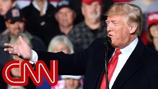Trump debuts new slogan and conspiracy theory