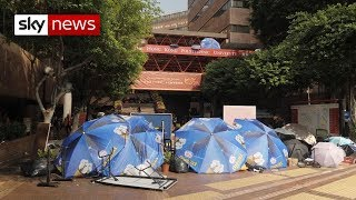 Hong Kong students battle with police