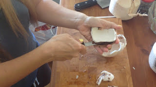 Genius way to take the meat out of a young coconut in one piece? simple just stick your hand in it