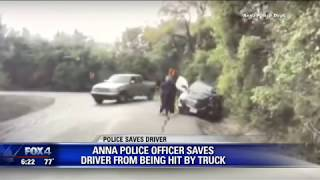 Police officer saves woman from being hit by truck