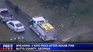 House fire leaves two children dead, mother clinging to life