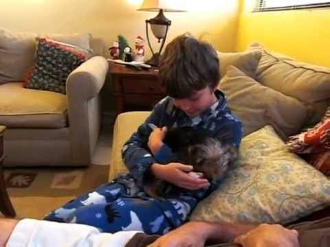 The sweetest boy gets dog for christmas EVER!