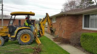 Gas line Replacement - Backhoe digging near the foundation.