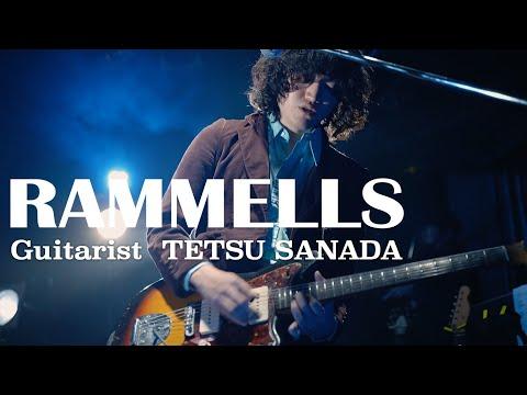 TETSU SANADA plays the guitar