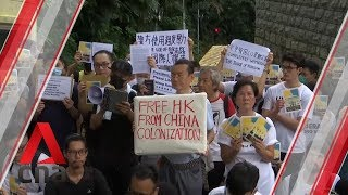 Hong Kong protesters march to foreign consulates over extradition Bill