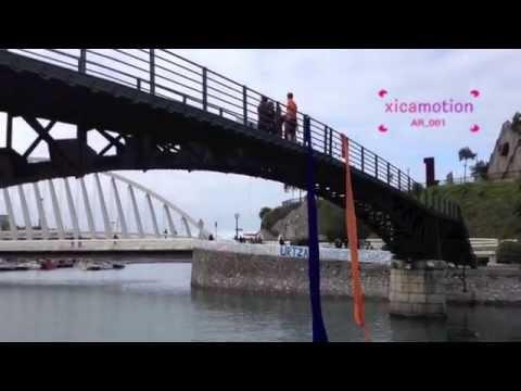 Rope acrobats at a bridge