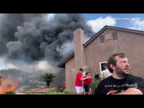 Pilot, truck driver killed as plane crashes into houses, elderly couple rescued