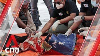 Indonesia Sriwijaya Air crash: Suspected plane debris, human body parts found