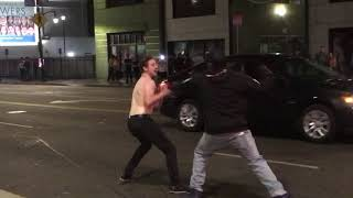 Night fight on Hollywood Boulevard