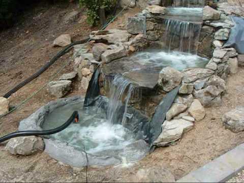 Como instalar agua para una cascada musica movil for Cascadas de jardin