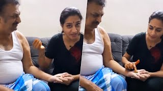 Actress Surekha Vani applies Mehendi on her father's hand..