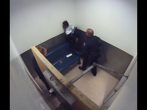 Officer shoves handcuffed suspect