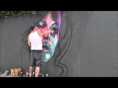 Graffiti artist Robin Munro spray paints a mural in honor of World Hepatitis Day 2015 street art fair hosted by Hep C Connection at Denver's Owl and Orchid Tattoo. Several artists painted a 60 foot span of wall in the alley while attendees reflected on the 4,000 lives lost globally to hepatitis every day. Free hepatitis C screening and other education resources were available. Hepatitis C can be cured but, because it can progress in silence, many who have it don't know.