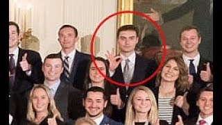 Former White House intern flash 'white power' hand gesture in photo with Trump