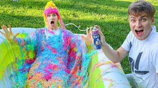 10,000 CANS OF SILLY STRING VS POOL!!