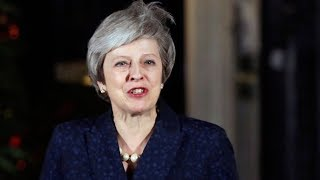 Theresa May wins party non-confidence vote amid Brexit turmoil