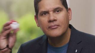 Reggie reveals the Pokéball Plus