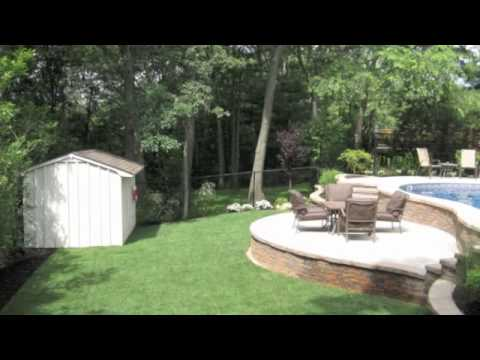 Swimming pools built on hills sloped yards travertine - Building a swimming pool on a slope ...