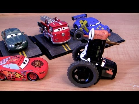 Cars 2 Tractor Chase Disney Store Prince Wheeliam, Metallic Red Chase Collector Acrylic Display Case - Smashpipe Entertainment Video