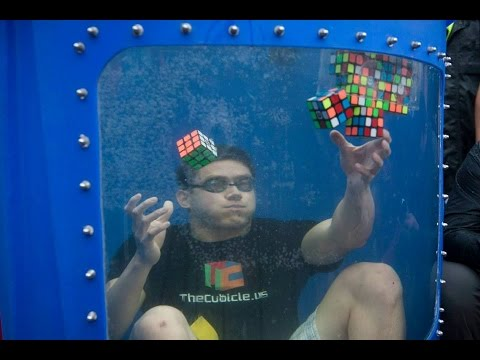 World Record! 8 Rubik's Cubes Solved Underwater