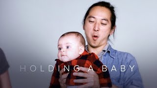 Holding a Baby for the First Time in Slow Motion - First Takes
