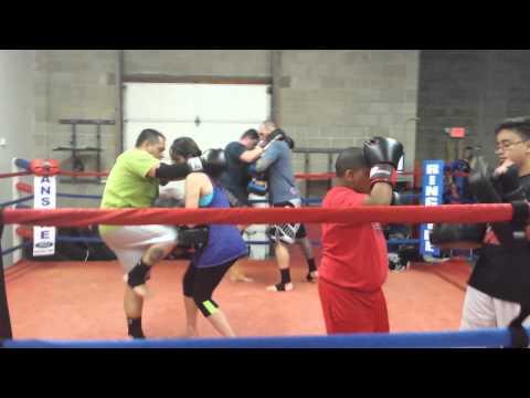 Muay Thai Training in the ring partner drills.