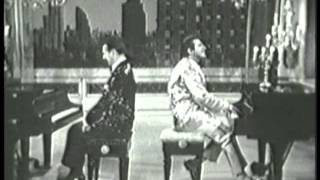 Liberace performing Night and Day and There'll Be No New Tunes On This Old Piano