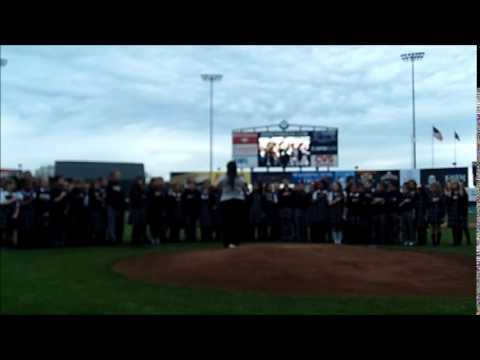 Scholars sing the national anthem at a PawSox game