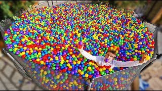 TRAMPOLINE FILLED WITH 160,000 PLASTIC BALLS (BALL PIT)