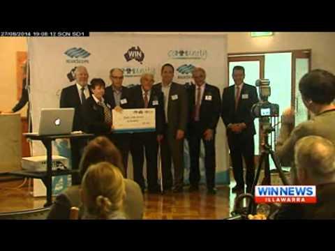 BlueScopeWIN Cheque Handover WIN News 27 August 2014