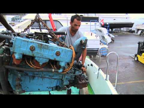 Removing the second 318 Chrysler V8 from a Tollycraft Sportfisher