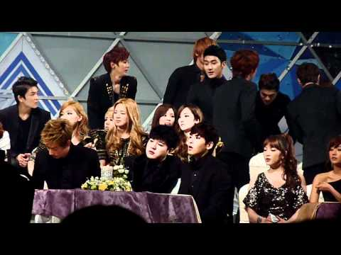 111229 Hyuk sitting on Kyu's lap