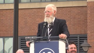 David Letterman jokes with the crowd during the Peyton Manning statue unveiling