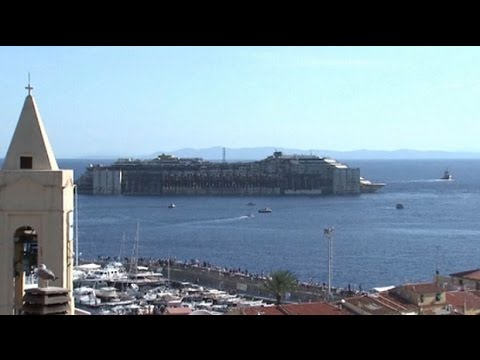 Celebration in Giglio as Costa Concordia heads for scrapheap - The Telegraph  - jtJGvDtcxa8 -