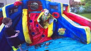 Scary Clown Attacks Through Inflatable Water Slide!