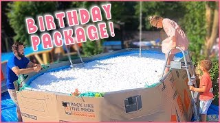 Jumping into Her Giant Birthday Package!