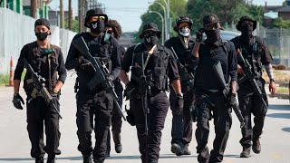Heavily armed protesters march through Louisville demanding justice for Breonna Taylor