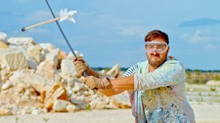 Slicing an Arrow in Half Mid-Air in Slow Motion - The Slow Mo Guys